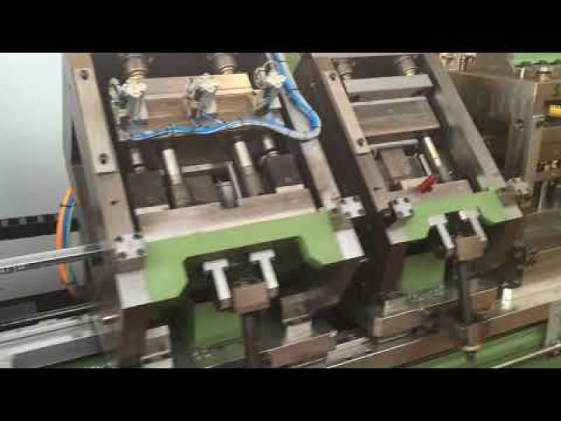 Automatic profiling line with cutting on the fly for the production of drawer guides